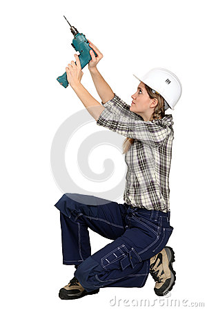 A female handyman with a drill.