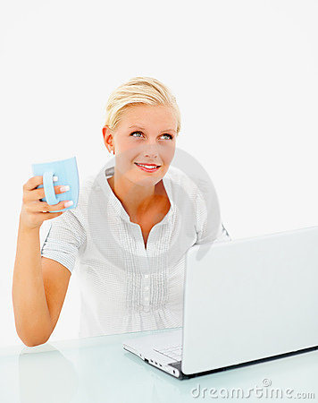 Female having coffee while using a laptop