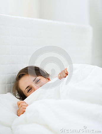 Female hiding behind blanket
