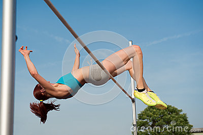 Female high jumper in action
