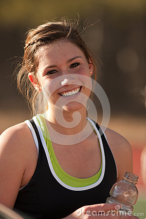 Female High School Athlete Smiles