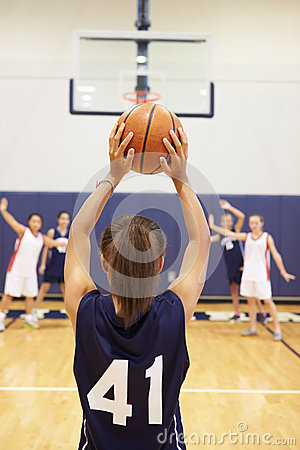 Free Female High School Basketball Player Shooting Basket Royalty Free Stock Photos - 41530188