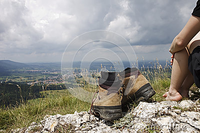 Female Hiker barefoot with hiking boots