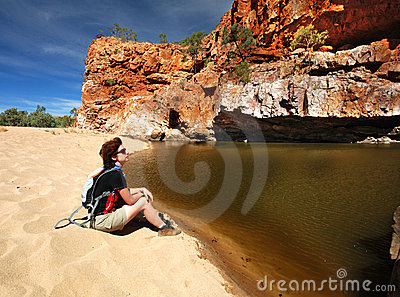 Female hiker near waterhole