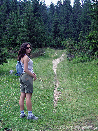 Female hiker on wooded trail
