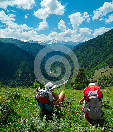 Female hikers rest and enjoy landscape