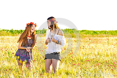 Female hippies in field