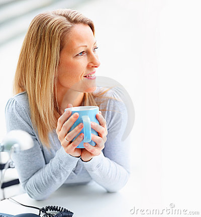 Female holding a coffee cup