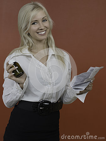 Female holding glass of pills