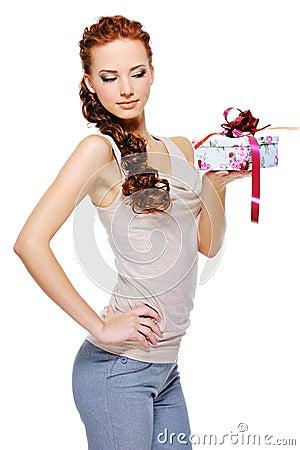 Female holding in hand little white present box