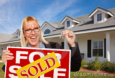 Female Holding Keys & Sold Real Estate Sign