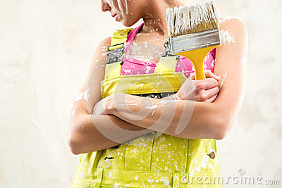 Female holding paint brush
