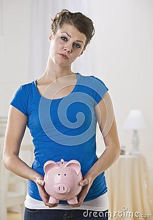 Female Holding Piggy Bank
