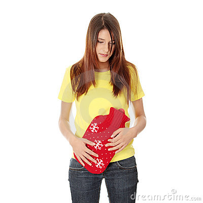 Female holding red hot water bottle