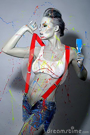 Free Female House Painter Splattered With Latex Paint Royalty Free Stock Photography - 34169327