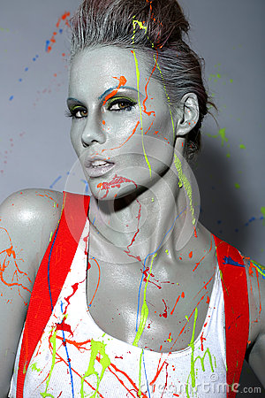 Free Female House Painter Splattered With Latex Paint Stock Image - 35057541