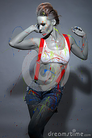 Free Female House Painter Splattered With Latex Paint Stock Photo - 35057630