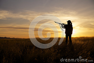 Female Rifle Hunter in Sunset