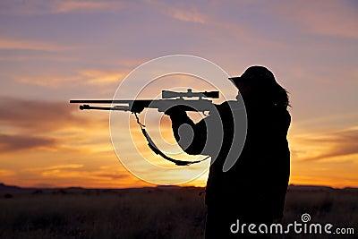 Female Hunter in Sunset
