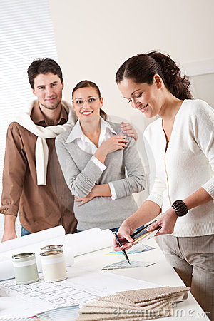 Female interior designer with two clients
