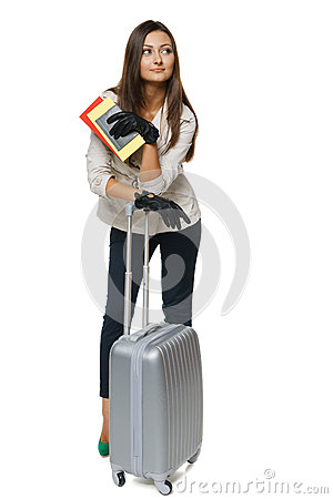 Female in jacket standing with travel bag