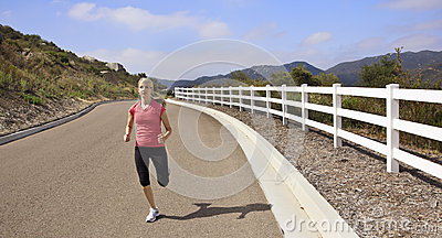 Female Jogger running on the road