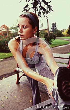 Female jogger strecting. 2