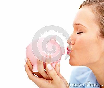 Female kissing piggybank and copyspace