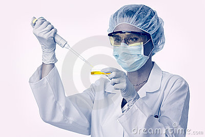 Female lab technician with pipette and liquid