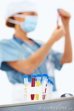 Female lab worker holding up test tube