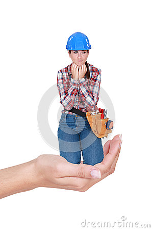 Laborer crouching in a hand