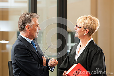 Female lawyer with civil law code and client