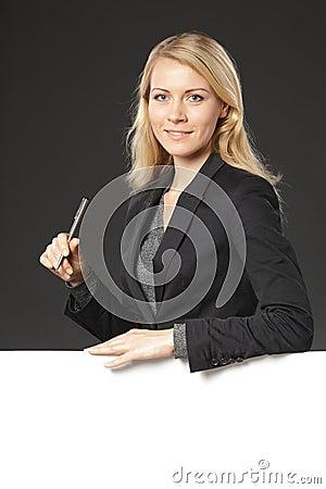 Female leaning on whiteboard