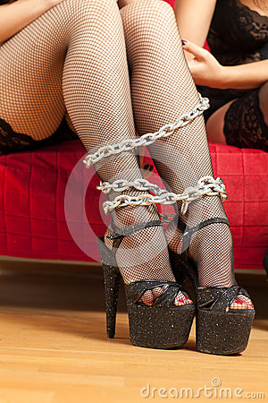 Female legs and chain
