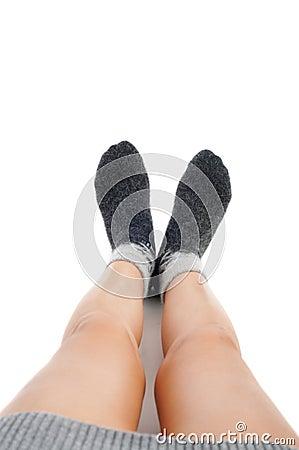Female legs in grey wool socks