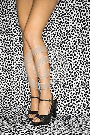 Female legs in heels.