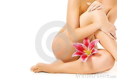 Female legs with pink lily