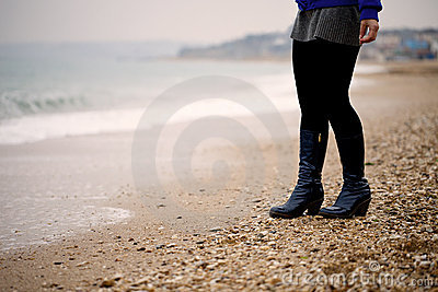 Female legs at the seaside