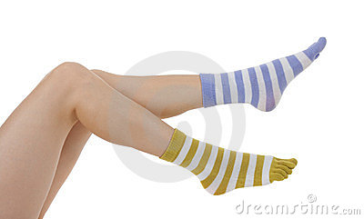 Female legs in socks of different colors