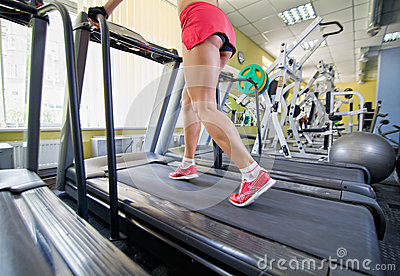 Female legs on a treadmill