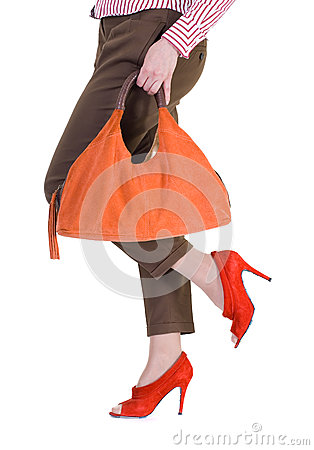 female legs wearing elegant red shoes.