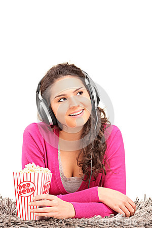 Female listening to music and eating popcorn