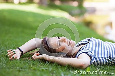 Female lying on grass