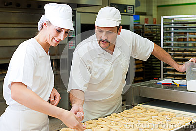 Female and male baker in bakery
