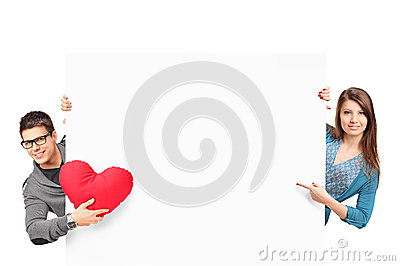 Female and male with heart shaped object