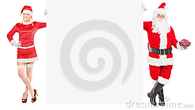 Female and male like Santa Claus holding a panel