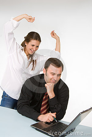 Female and male managers, working on laptop