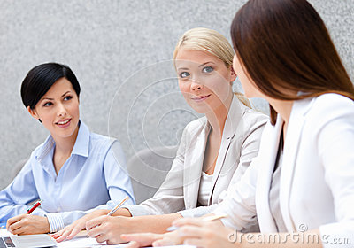 Female managers discuss business plan