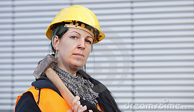 Female manual worker with hammer