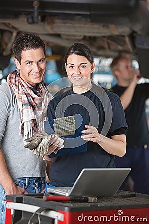 Female mechanic with customer